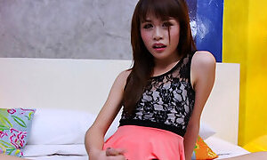 Asian shemale masturbates her hard shaft in the bedroom