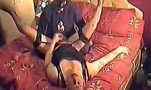 British girl pegging boyfriend dressed in lingerie