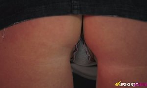 Blonde babe with plump ass Nikki Lee shows off upskirt pussy