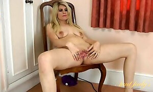 Housewife vacuums the floor naked