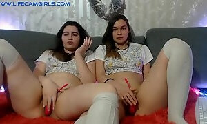 Twin sisters spread their legs and fingering lovense