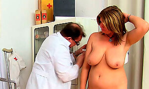 Mature woman with huge boobs visits kinky gyno specialist