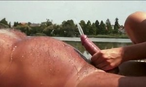 Dolly Diore has a golden shower with an old man by the lake xVideos