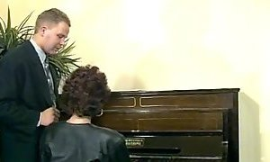 Kinky mature piano lesson