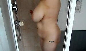 My new lover soaping up her natural 34HH tits in the shower